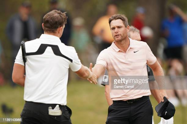 Lucas Bjerregaard of Denmark shakes hands with Matt Wallace of England after defeating him 1up during the third round of the World Golf...