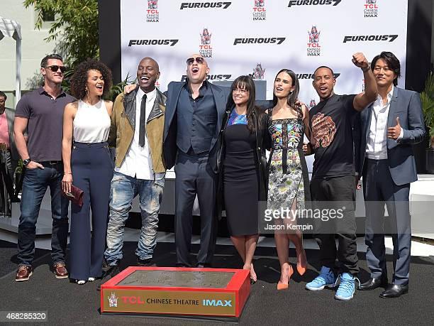Lucas Black Nathalie Emmanuel Tyrese Gibson Vin Diesel Michelle Rodriguez Jordana Brewster Ludacris and Tatchakorn Yeerum attend Vin Diesel's hand...