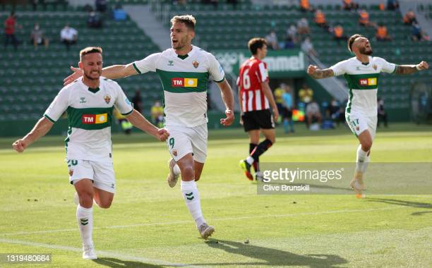 Lucas Boye of Elche CF celebrates after scoring their team's first goal with Pablo Piatti during the La Liga Santander match between Elche CF and...