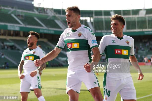 Lucas Boye of Elche CF celebrates after scoring their team's first goal with Guti during the La Liga Santander match between Elche CF and Athletic...