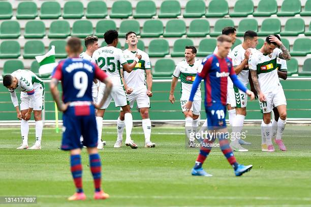 Lucas Boye of Elche CF celebrates with team mates after scoring their side's first goal during the La Liga Santander match between Elche CF and...