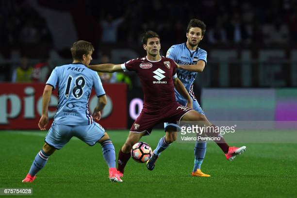 Lucas Boye of FC Torino is challenged by Bartosz Bereszynski and Dennis Praet of UC Sampdoria during the Serie A match between FC Torino and UC...