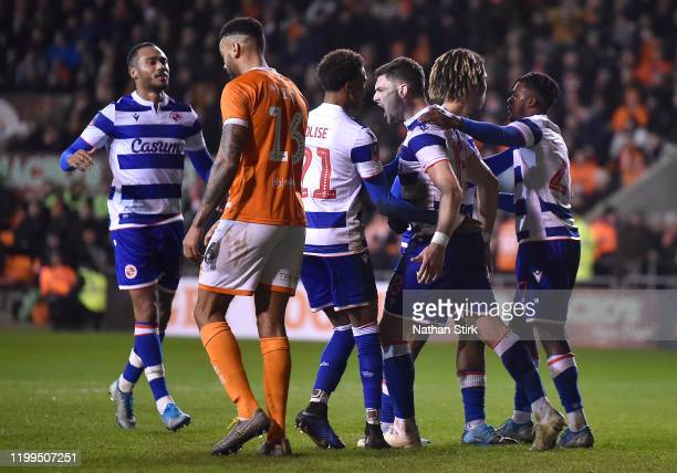Lucas Boye of Reading celebrates with his team mates after scoring his team's first goal during the FA Cup Third Round Replay match between Blackpool...