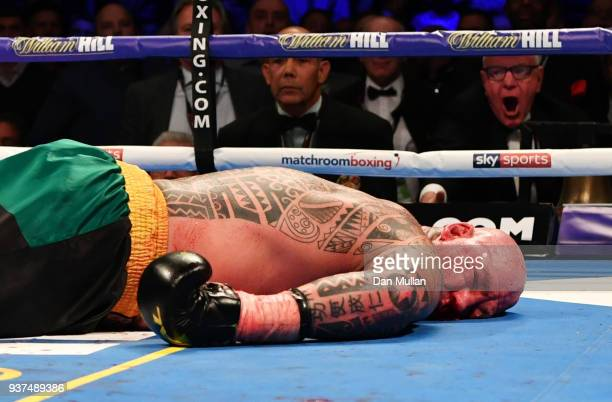 Lucas Browne lays on the canvas as he is knocked out by Dillian Whyte in the sixth round during their WBC Silver Heavyweight Championship at The O2...