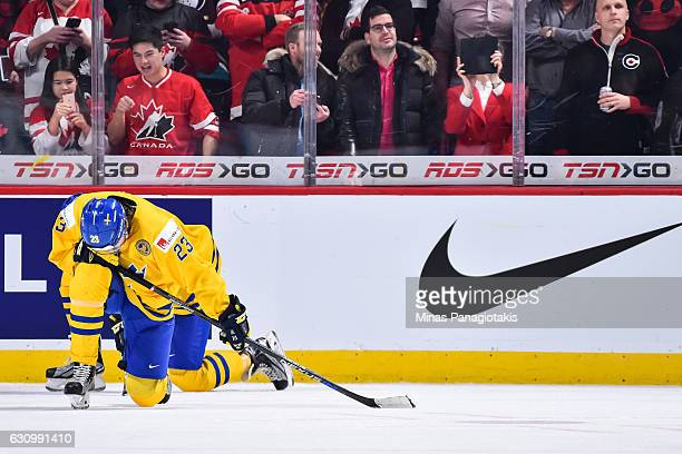Lucas Carlsson of Team Sweden reacts after losing to Team Canada during the 2017 IIHF World Junior Championship semifinal game at the Bell Centre on...