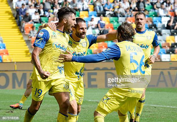 Lucas Castro of AC ChievoVerona celebrates with his team mate's after scoring his team's first goal during the Serie A match between Udinese Calcio...