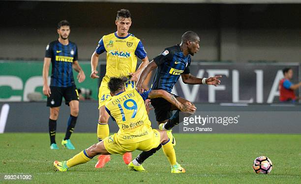 Lucas Castro of AC ChievoVerona competes with Geoffrey Kondogbia of FC Internazionale during the Serie A match between AC ChievoVerona and FC...