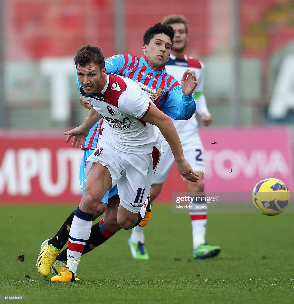 Lucas Castro (R) of Catania competes for the ball with Marco Motta of Bologna during the Serie A match between Calcio Catania and Bologna FC at Stadio Angelo Massimino on February 17, 2013 in Catania, Italy.