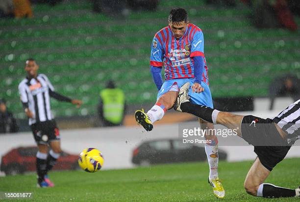 Lucas Castro of Catania scores his team's first goal during the serie A match between Udinese and Catania at Stadio Friuli on October 31, 2012 in...
