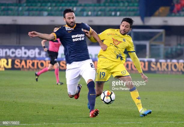 Lucas Castro of Chievo Verona competes with Simone Calvano of Hellas Verona during the serie A match between Hellas Verona FC and AC Chievo Verona at...