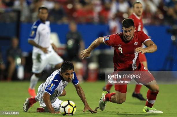 Lucas Cavallini of Canada dribbles the ball past Jorge Claros of Honduras during the 2017 CONCACAF Gold Cup at Toyota Stadium on July 14 2017 in...