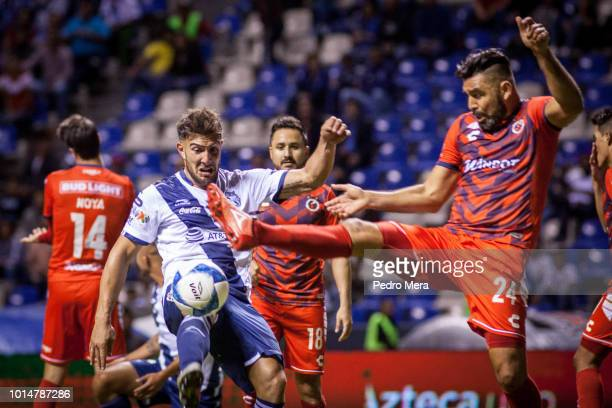 Lucas Cavallini of Puebla and Jose Rivas of Veracruz fight for the ball during the 4th round match between Puebla and Veracruz as part of the Torneo...