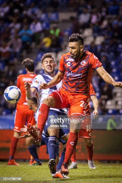 Lucas Cavallini of Puebla and Jose Rivas of Veracruz fight for the ball during a match between Puebla and Veracruz as part of Torneo Apertura Liga MX...