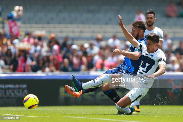 Lucas Cavallini of Puebla and Josecarlos Van Rankin of Pumas fight for the ball during the 15th round match between Pumas UNAM and Puebla as part of...