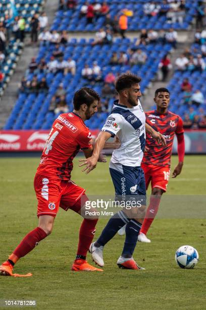 Lucas Cavallini of Puebla and Rodrigo Moya of Veracruz fight for the ball during a match between Puebla and Veracruz as part of Torneo Apertura Liga...