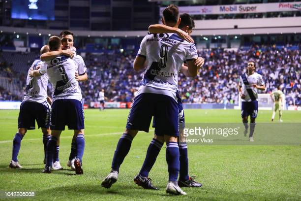 Lucas Cavallini of Puebla celebrate with teammates after scoring the first goal of his team during the 10th round match between Puebla and America as...