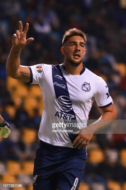 Lucas Cavallini of Puebla celebrates after scoring his team's first goal during the 1st round match between Puebla and Cruz Azul as part of the...