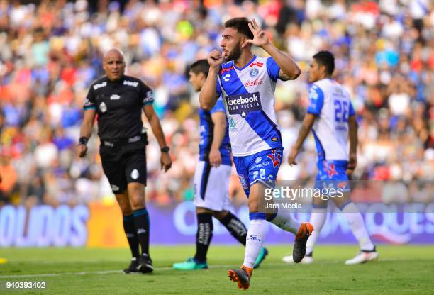 Lucas Cavallini of Puebla celebrates after scoring his team´s first goal during the 13th round match between Queretaro and Puebla as part of the...