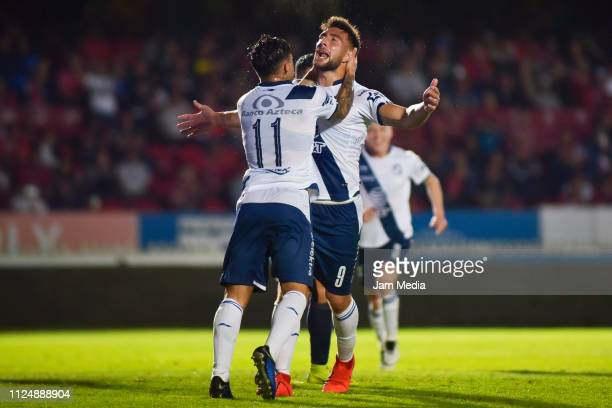 Lucas Cavallini of Puebla celebrates after scoring the first goal of his team with teammate during the 4th round match between Veracruz and Puebla as...