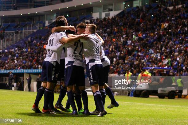 Lucas Cavallini of Puebla celebrates with teammates after scoring his team's first goal during the 1st round match between Puebla and Cruz Azul as...