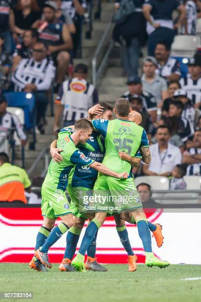 Lucas Cavallini of Puebla celebrates with teammates after scoring his team's third goal during the 10th round match between Monterrey and Puebla as...