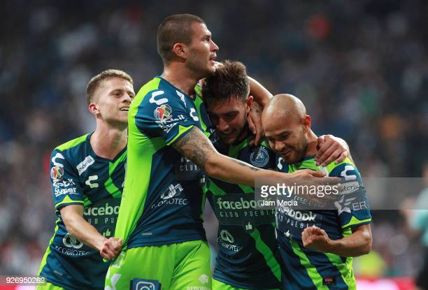 Lucas Cavallini of Puebla celebrates with teammates after scoring the third goal of his team during the 10th round match between Monterrey and Puebla...