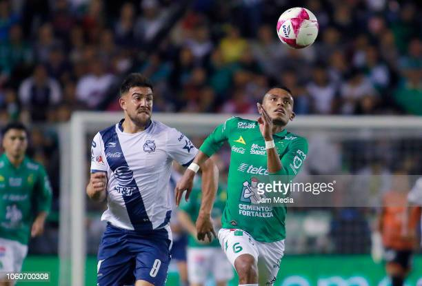 Lucas Cavallini of Puebla fights for the ball with William Tesillo of Leon during the 14th round match between Leon and Puebla as part of the Torneo...