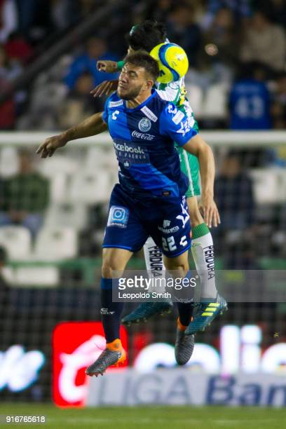 Lucas Cavallini of Puebla figths for the ball with Miguel Herrera of Leon during the 6th round match between Leon and Puebla as part of the Torneo...