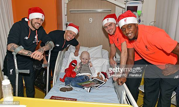 Lucas Connor Randall Danny Ings and Divock Origi of Liverpool at Alder Hey Children's Hospital on December 23 2016 in Liverpool England