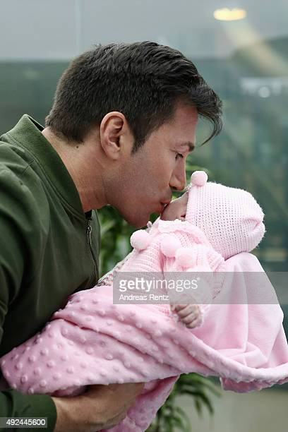 Lucas Cordalis kisses newborn daughter Sophia on October 13 2015 in Cologne Germany It was first public appearance of the couple Daniela Katzenberger...