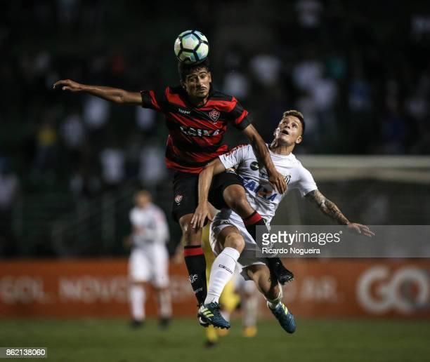 Lucas Crispim of Santos battles for the ball with Ramon of Vitoria during the match between Santos and Vitoria as a part of Campeonato Brasileiro...