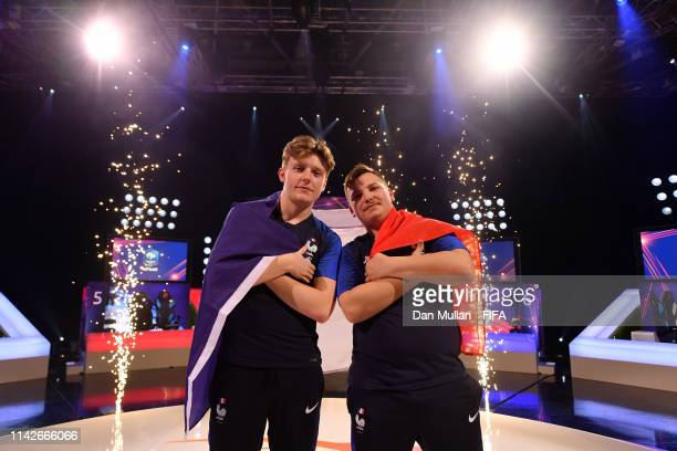 Lucas 'DaXe' Cuillerier of France and Corentin 'MAESTRO' Thullier of France pose for a photo after winning the tournament during Day 2 of FIFA...
