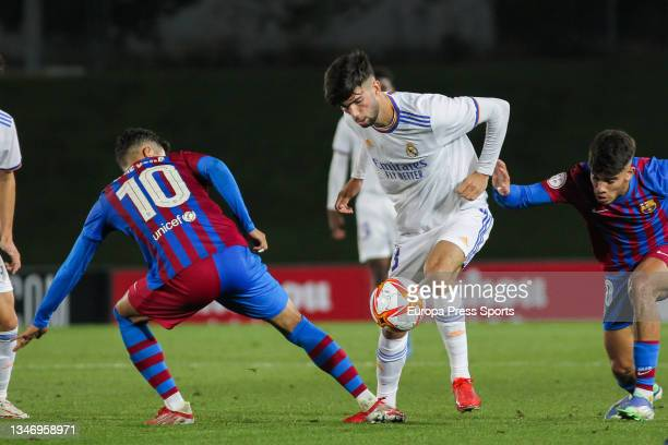 Lucas de Vega and Theo Zidane of Real Madrid Castilla in action during Primera RFEF Group 2 football match played between Real Madrid Castilla and FC...
