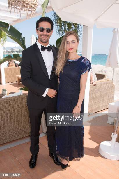 Lucas di Grassi and Bianca Diniz Caloi attend a cocktail party hosted by Alejandro Agag ahead of the World Premiere of the Formula E documentary And...