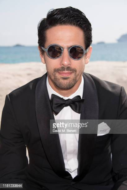 Lucas di Grassi attends a cocktail party hosted by Alejandro Agag ahead of the World Premiere of the Formula E documentary And We Go Green during the...