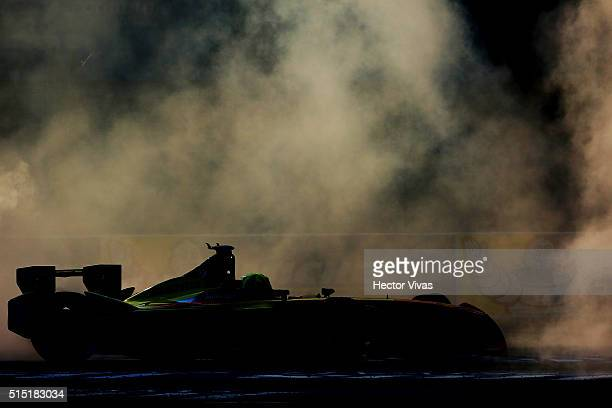 Lucas di Grassi of Brazil and ABT Schaeffler Audi Sport celebrates by skidding his car after winning the Mexico City Formula E Championship 2016 at...