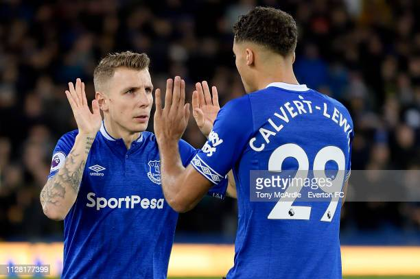 Lucas Digne and Dominic CalvertLewin during the Premier League match between Everton and Manchester Cit at Goodison Park on February 6 2019 in...