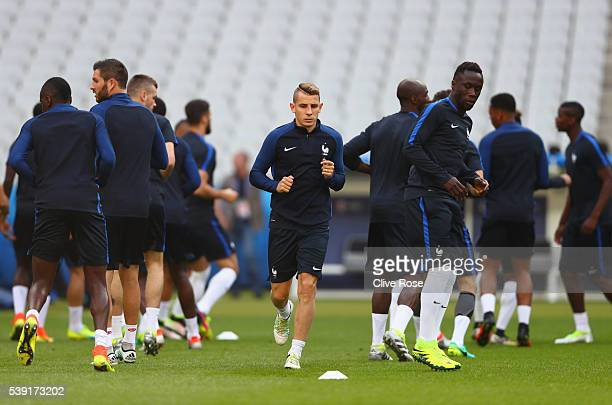 Lucas Digne and French players warm up during training session ahead of the UEFA EURO 2016 Group A match between France and Romania at Stade de...