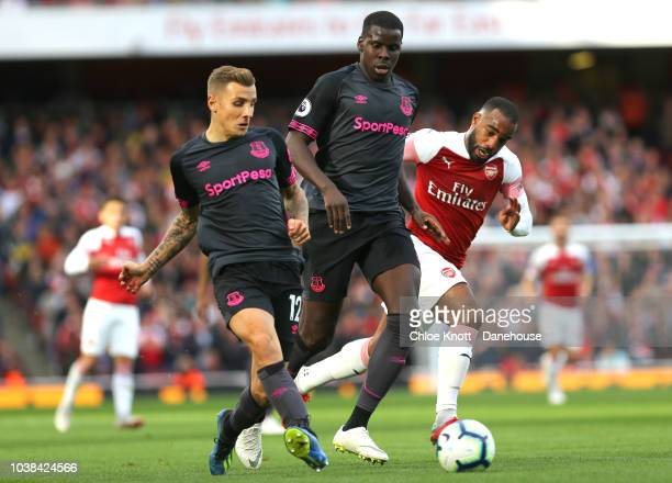 Lucas Digne and Kurt Zouma of Everton and Alexandre Lacazette of Arsenal in action during the Premier League match between Arsenal and Everton at The...