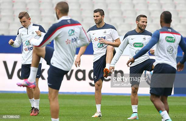 Lucas Digne AndrePierre Gignac Yohan Cabaye of France warm up during practice on the eve of the international friendly match between France and...