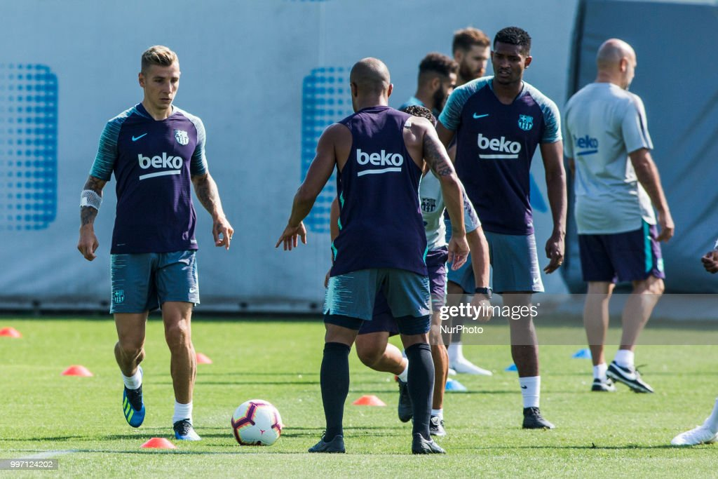 Lucas Digne from France, Marlon Santos from Brasil and Rafinha Alcantara from Brasil during the first FC Barcelona training session of the 2018/2019 La Liga pre season in Ciutat Esportiva Joan Gamper, Barcelona on 11 of July of 2018.