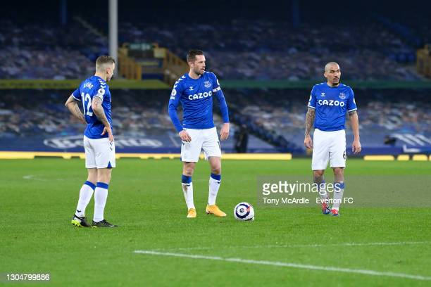 Lucas Digne Gylfi Sigurdsson and Allan of Everton during the Premier League match between Everton and Southampton at Goodison Park on March 2021 in...