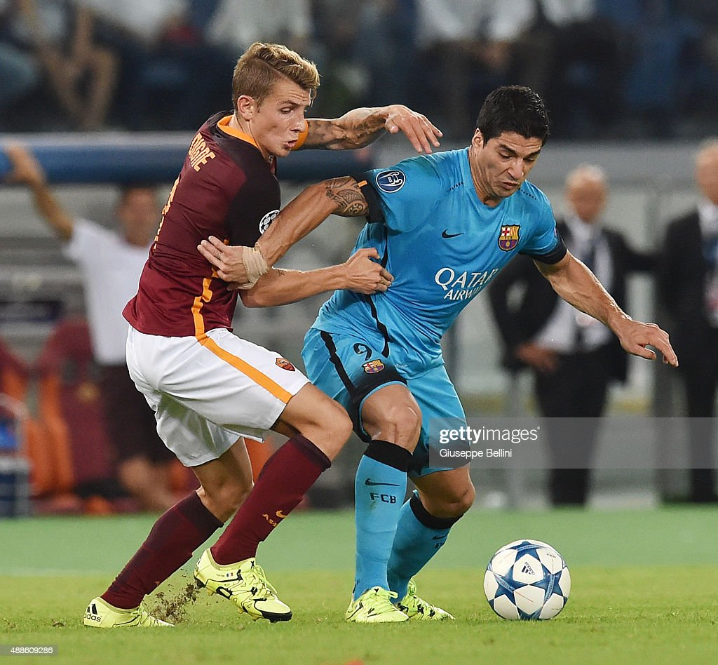 Lucas Digne of AS Roma and Luis Suarez of FC Barcelona in action during the UEFA Champions League Group E match between AS Roma and FC Barcelona, at Olimpico Stadium on September 16, 2015 in Rome, Italy.