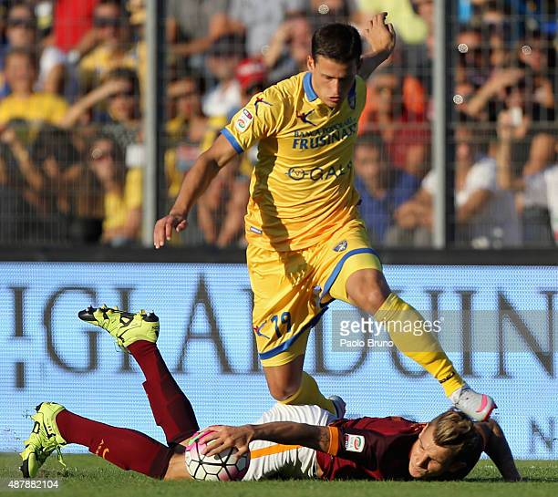 Lucas Digne of AS Roma competes for the ball with Alexandar Tonev of Frosinone Calcio during the Serie A match between Frosinone Calcio and AS Roma...