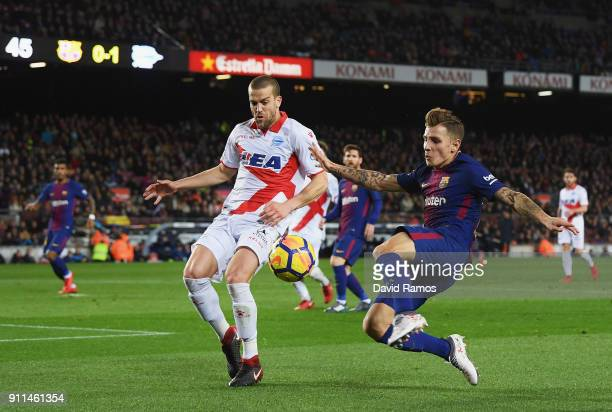 Lucas Digne of Barcelona battles for posession with Víctor Laguardia of Alaves during the La Liga match between Barcelona and Deportivo Alaves at...