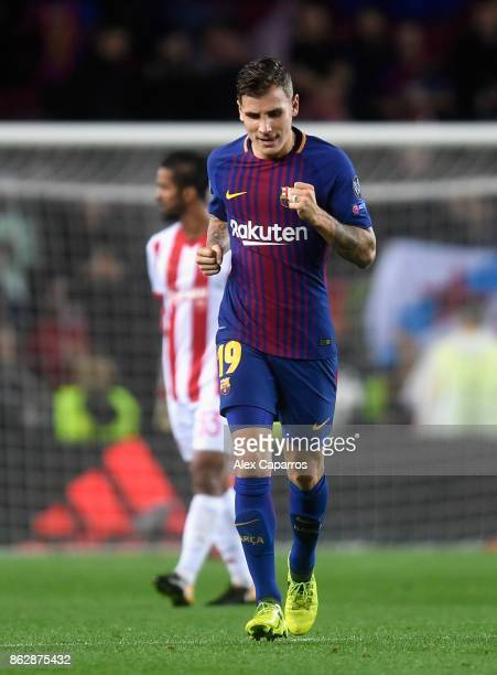 Lucas Digne of Barcelona celebrates scoring his sides third goal during the UEFA Champions League group D match between FC Barcelona and Olympiakos...