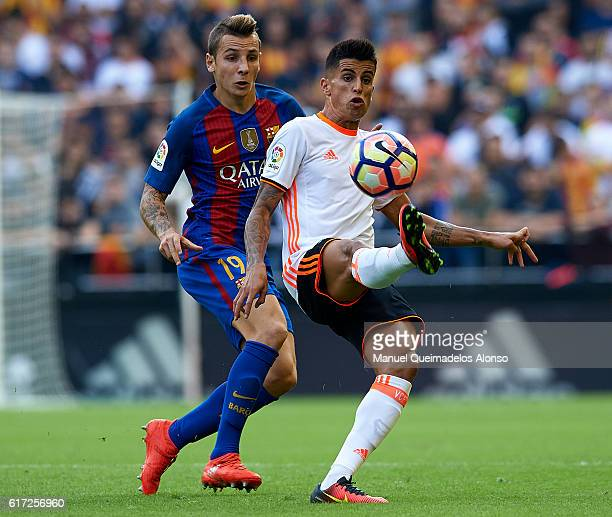 Lucas Digne of Barcelona competes for the ball with Joao Cancelo of Valencia during the La Liga match between Valencia CF and FC Barcelona at...