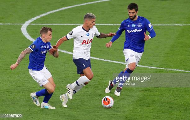 Lucas Digne of Everton and Andre Gomes of Everton battles for possession with Erik Lamela of Tottenham Hotspur during the Premier League match...