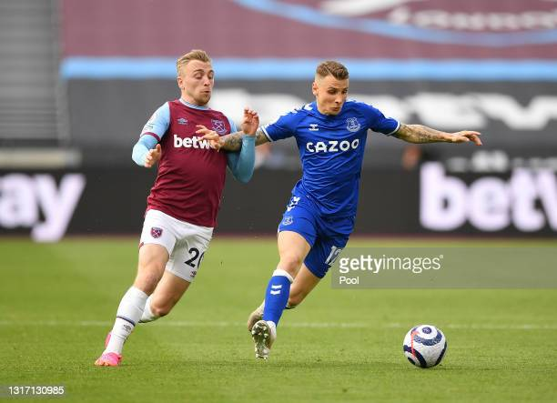 Lucas Digne of Everton battles for possession with Jarrod Bowen of West Ham United during the Premier League match between West Ham United and...