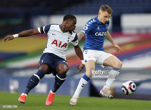 Lucas Digne of Everton battles for possession with Serge Aurier of Tottenham Hotspur during the Premier League match between Everton and Tottenham...